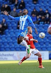 Colchester United's Gavin Massey is challenged by Bristol City's Simon Gillett - Photo mandatory by-line: Dougie Allward/JMP - Mobile: 07966 386802 22/03/2014 - SPORT - FOOTBALL - Colchester - Colchester Community Stadium - Colchester United v Bristol City - Sky Bet League One