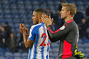 Huddersfield Town's Mathias Zanka Jørgensen and Huddersfield Town's Jonas Lössl applaud the fans at full time  during the Premier League match between Huddersfield Town and West Ham United at the John Smiths Stadium, Huddersfield, England on 13 January 2018. Photo by Paul Thompson.