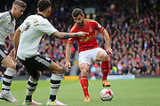 Nottingham Forest defender Bojan Jokic (3) surrounded by Fulham players during the Sky Bet Championship match between Fulham and Nottingham Forest at Craven Cottage, London, England on 23 April 2016. Photo by Matthew Redman.
