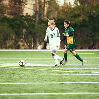 4th year defender, Brigit Sinaga (24) of the Regina Cougars during the Women's Soccer home game on Sun Sep 23 at U of R Field. Credit: Arthur Ward/Arthur Images