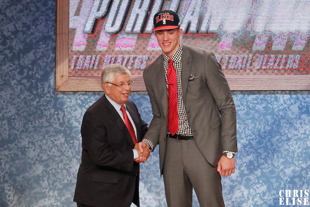 28 June 2012: Meyers Leonard, picked up by the Portland Trailblazers, poses with David Stern during the 2012 NBA Draft, at the Prudential Center, Newark, New Jersey.