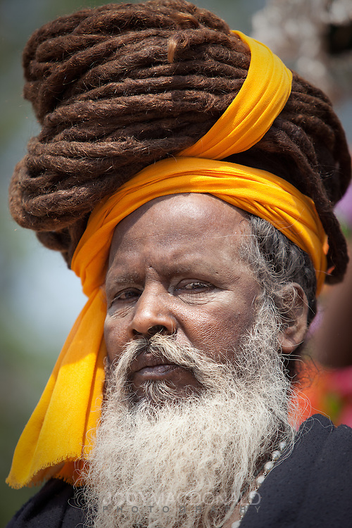 old man with massive dreadlocks wrapped over head at kumbh mela, india