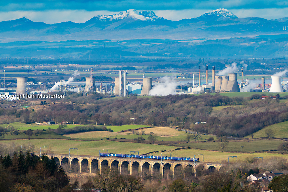 Railway viaduct and INEOS Grangemouth petrochemical plant and oil refinery in Scotland, UK