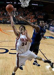 Virginia Cavaliers forward/center Ryan Pettinella (34) grabs a rebound from Longwood Lancers forward Clayton Morgan (1).  The Virginia Cavaliers Men's Basketball Team defeated Longwood University 90-49 at the John Paul Jones Arena in Charlottesville, VA on February 13, 2007.