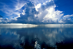 Stock photo of large cloud formations over calm waters in Galveston Bay