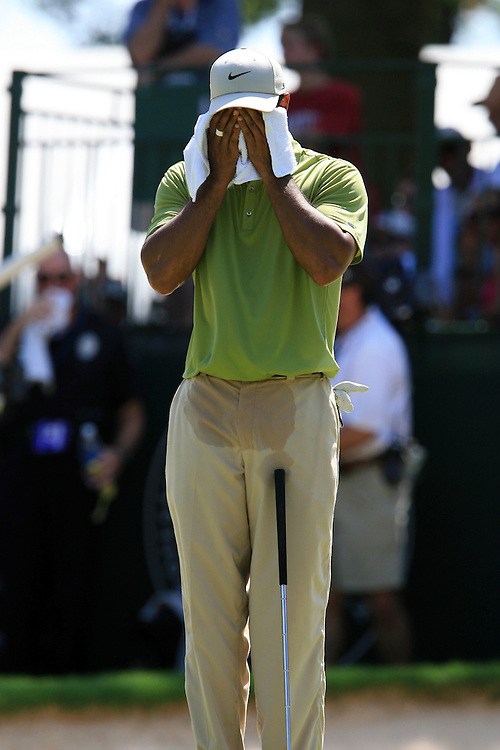 11 August 2007: Tiger Woods wipes his face on the 5th green as temperatures exceed 100 degrees during the third round of the 89th PGA Championship at Southern Hills Country Club in Tulsa, OK.