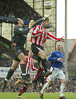 Photo: Aidan Ellis.<br /> Everton v Sunderland. The Barclays Premiership. 01/04/2006.<br /> everton keeper Richard Wright just gets to the ball before Sunderland's Chris Brown