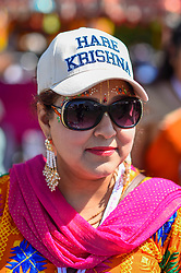 © Licensed to London News Pictures. 23/08/2019. LONDON, UK. A devotee wears a Hare Krishna hat as thousands celebrate the birth of Lord Krishna at the Janmashtami festival at the Bhaktivedanta Manor Hare Krishna Temple in Watford, Hertfordshire.  The manor was donated to the Hare Krishna movement by ex Beatle George Harrison and annually hosts the biggest Janmashtami festival outside of India.  Photo credit: Stephen Chung/LNP