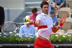 Serbia's Novak Djokovic plays against Spain's Jaume Munar during their men's singles second round match on day four of The Roland Garros 2018 French Open tennis tournament in Paris on May 30, 2018. Photo by Christian Liewig/ABACAPRESS.COM