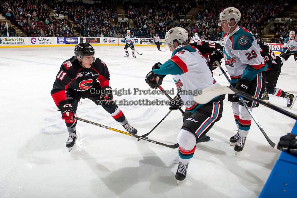 KELOWNA, CANADA - FEBRUARY 18: Josh Maser #11 of the Prince George Cougars checks Tomas Soustal #15 of the Kelowna Rockets in front of the bench during first period on February 18, 2017 at Prospera Place in Kelowna, British Columbia, Canada.  (Photo by Marissa Baecker/Shoot the Breeze)  *** Local Caption ***