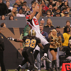 2008 December, 07: Atlanta Falcons wide receiver Brian Finneran (86) leaps for a touchdown catch over New Orleans Saints cornerback Usama Young (28) during the first half of a game between NFC South divisional rivals the Atlanta Falcons and the New Orleans Saints at the Louisiana Superdome in New Orleans, LA.