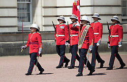 © Licensed to London News Pictures. 26/06/2017. London, UK. Captain Megan Couto (L) of the 2nd Battalion, Princess Patricia's Canadian Light Infantry becomes the first woman to command the Queen's Guard at Buckingham Palace. The Canadian Light Infantry are taking part in the Changing of the Guard Ceremony as part of the 150th anniversary of the founding of the nation of Canada. Photo credit: Peter Macdiarmid/LNP