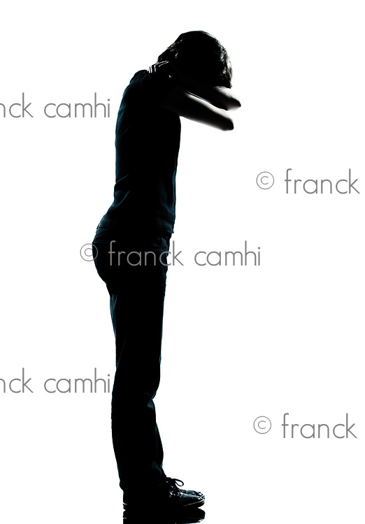one caucasian young teenager silhouette boy or girl crying full length in studio cut out isolated on white background