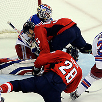 28 April 2009:   Washington Capitals defenseman Mike Green (52) is called for interference after running into New York Rangers goalie Henrik Lundqvist (30) in the 1st period in the seventh game of the Eastern Conference NHL quarterfinal playoff game at the Verizon Center in Washington, D.C.  The Washington Capitals defeated the New York Rangers 2-1 in the Eastern Conference NHL quaterfinal playoff to advance to the second round of the playoffs.