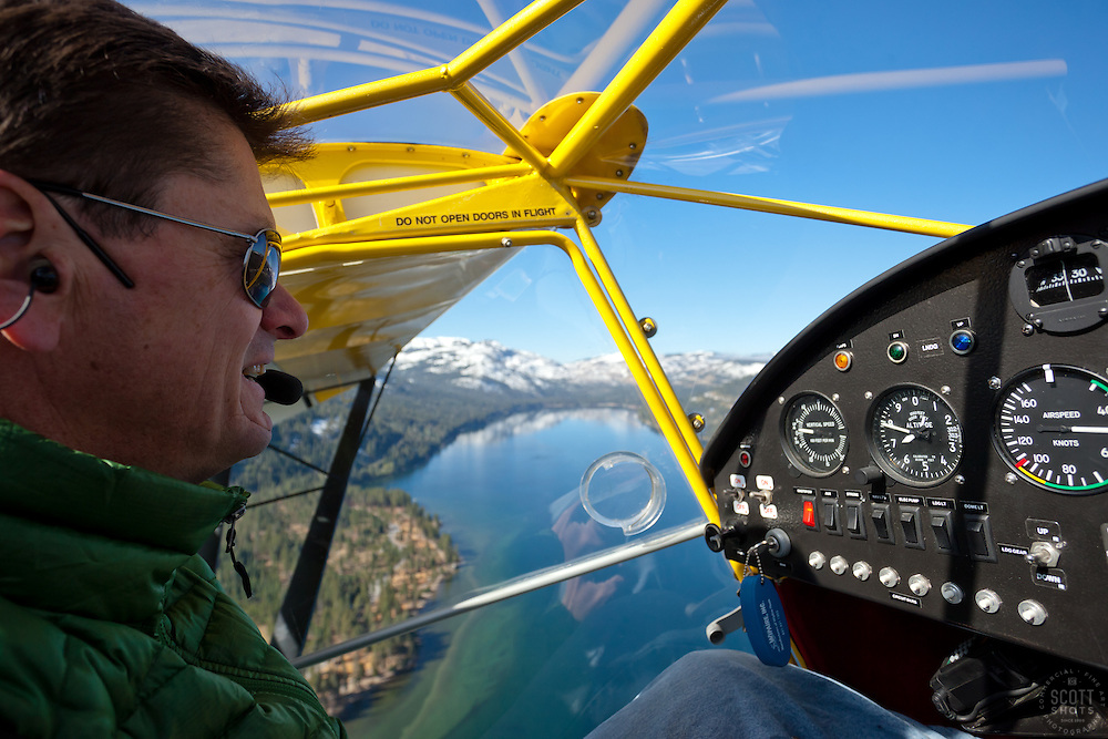 """Pilot over Donner Lake"" - This pilot was photographed flying an amphibious seaplane over Donner Lake, CA."