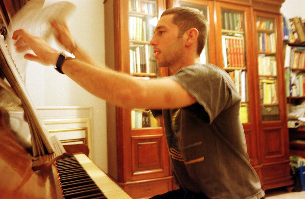 Lt. Avishai, at home playing the piano, as he has been doing since childhood...Photo: Nadav Neuhaus