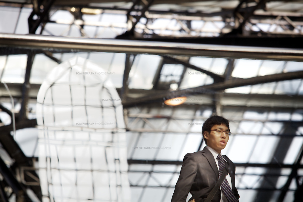 An office worker arrives at Liverpool Street Station in the City of London...Photo: Tom Pietrasik.London, U.K..May 2011