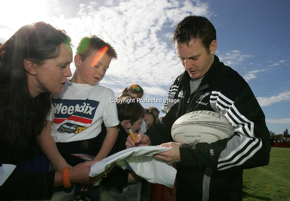 Andrew Mehrtens signs autographs for fans during the All Blacks training session at Silverdale United RFC, North of Auckland, New Zealand, Wednesday 7th July 2004. The All Blacks play the Pacific Islanders on Saturday.<br />