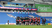 Japan players huddle for a team talk during the Japan Captain's Run training session in preparation for the Rugby World Cup at the American Express Community Stadium, Brighton and Hove, England on 18 September 2015.
