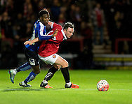 Sam Sheridan of FC United of Manchester (right) holds off Gboly Ariyibi of Chesterfield during the FA Cup match at Broadhurst Park, Moston<br /> Picture by Russell Hart/Focus Images Ltd 07791 688 420<br /> 09/11/2015