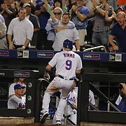 NEW YORK, NEW YORK - June 30: Brandon Nimmo #9 of the New York Mets head to the dugout after scoring the go ahead run in the seventh inning during the Chicago Cubs Vs New York Mets regular season MLB game at Citi Field on June 30, 2016 in New York City. (Photo by Tim Clayton/Corbis via Getty Images)