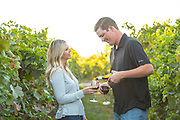 Man pouring wine for woman at Holeinsky Vineyard and Winery in Buhl, Idaho.