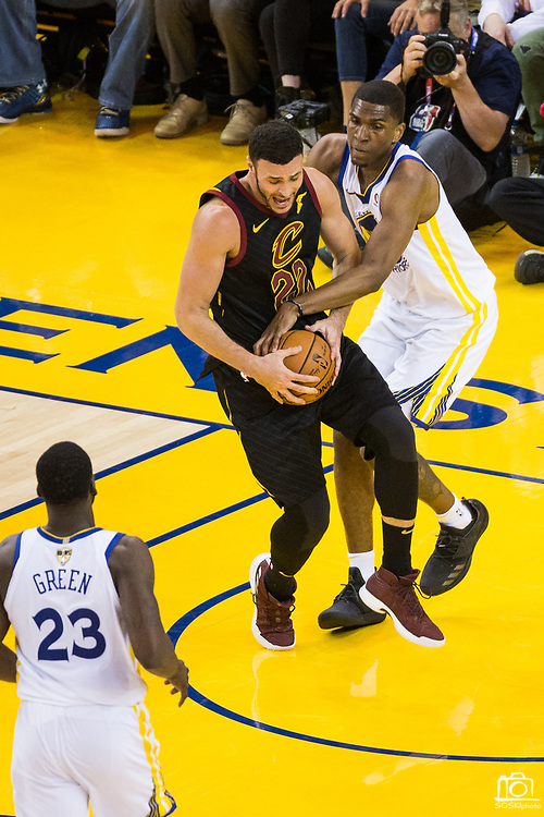 Golden State Warriors forward Kevon Looney (5) fouls Cleveland Cavaliers forward Larry Nance Jr. (22) during Game 1 of the NBA Finals at Oracle Arena in Oakland, Calif., on May 31, 2018. (Stan Olszewski/Special to S.F. Examiner)
