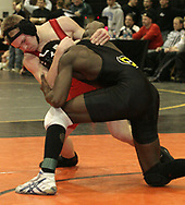 Centerville's Francois Hagenimana defeated Brandon Shaffer (left,) from Springfield North in the second round, to advance in the 2007 Division I Sectionals at Centerville High School, Friday night.