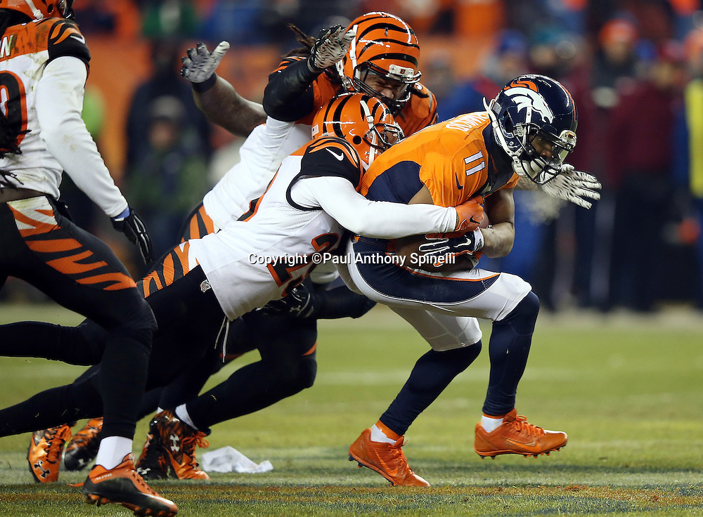 Denver Broncos wide receiver Jordan Norwood (11) gets gang tackled by Cincinnati Bengals strong safety Leon Hall (29) and Cincinnati Bengals middle linebacker Rey Maualuga (58) after catching a third quarter pass for a first down at mid-field during the 2015 NFL week 16 regular season football game against the Cincinnati Bengals on Monday, Dec. 28, 2015 in Denver. The Broncos won the game in overtime 20-17. (©Paul Anthony Spinelli)