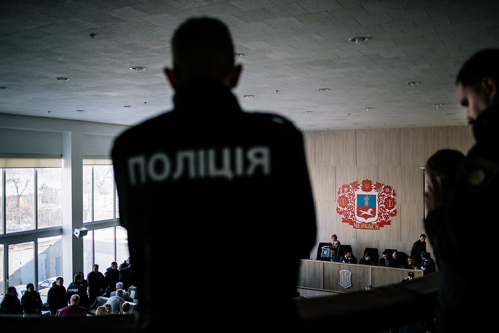 Cherkasy, Ukraine, 6 February 2018. <br /> Local parliament's session took place under heavy police surveilliance to avoid another protest by Natsionalny Druzhyna like what happend the previous week. <br /> Natsionalny Druzhyna (national brigades / patrols) are a volunteer branch of ultra-nationalist battalion &quot;Azov&quot; and of its political party &quot;Natsionalny Korpus (national body)&quot;. Created on January 28, Druzhyna's goal is to enforce civil security in Ukrainian streets aside from national police. Its methods as well as its position toward use of violence and respect of authority of the State are still unclear. Creation of Druzhyna and its first public actions stirred controversy within civil society and public opinion.<br /> <br /> &copy; Niels Ackermann / Lundi13