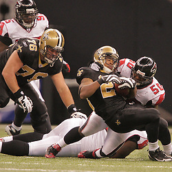 2008 December, 07: Atlanta Falcons linebacker Curtis Lofton (50) tackles New Orleans Saints running back Pierre Thomas (23) during a 29-26 victory by the New Orleans Saints over NFC South divisional rivals the Atlanta Falcons at the Louisiana Superdome in New Orleans, LA.