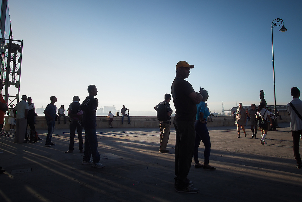 Silhouette of commuters waiting for their bus at the ferry Terminal in Havana Travel images from Havana Cuba. Pictures by Chris Pavlich Photography.