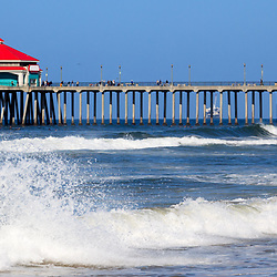 Huntington Beach Pier panoramic photo. Huntington Pier is a registered historic place in Huntington Beach California. Also known as Surf City USA, Huntington Beach is a popular Southern California coastal city in Orange County, CA.