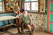 American artist Anado McLauchlin relaxes in the Chapel of Jimmy Ray in his art compound Casa las Ranas September 28, 2017 in La Cieneguita, Mexico.