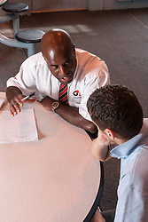 Prison officer in a one to one with a prisoner, UK prison