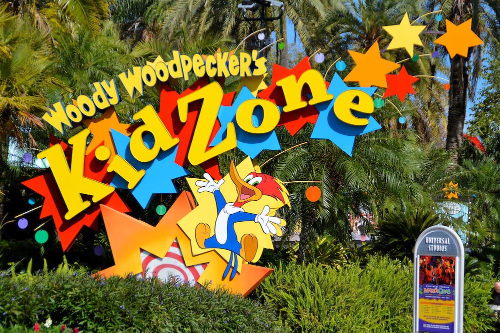 Woody Woodpecker&rsquo;s Kidzone Sign at Universal in Orlando, Florida<br /> The Kidzone at Universal features several lovable characters such as Barney, E.T. and Curious George. Woody Woodpecker is the host of the Nuthouse Coaster.  Children who enter this section have lots of fun but are too young to know its namesake. In case you are too, Woody Woodpecker was created by Warner Bros. studio in 1940. His iconic laugh was delivered by Mel Blanc who was called &ldquo;The Man of a Thousand Voices&rdquo; because he also created the voices of almost every Looney Tunes&rsquo; animated character.