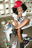 Teyana Taylor.16 yr old  rapper/singer/dancer who appeared on MTV's My Sweet 16 and is signed to Pharrell Williams record label at Atmos shoe store 203 west 125th st- in Harlem..When:.Thursday, Aug 2, 2007..Photo Credit; Rahav Segev/Photopass.com.