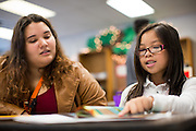 Reading Partners Regional Site Coordinator Stephanie Entizne tutors third grader Natalie Truong, 8, during the Reading Partners tutoring program at Rose Elementary School in Milpitas, California, on December 8, 2014. (Stan Olszewski/SOSKIphoto)