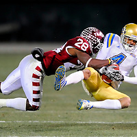 29 December 2009:   UCLA wide receiver Terrence Austin (4) catches an 11-yard pass in the 3rd quarter against Temple cornerback Marquise Liverpool (28).  The UCLA Bruins defeated the Temple University Owls 30-21 in the Eagle Bank Bowl in Washington, D.C.