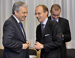 Luc Frieden, Luxembourg's minister of Finance, right, speaks with Didier Reynders, Belgium's finance minister, during Eurogroup, the meeting of finance ministers from the sixteen countries that use the Euro as their currency,  at EU Council headquarters in Brussels, Belgium, on Monday, Nov. 9, 2009. (Photo © Jock Fistick)