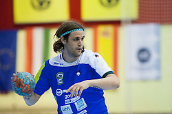 Dean Bombac #2 of Slovenia during handball match between National teams of Slovenia and Hungary in play off of 2015 Men's World Championship Qualifications on June 15, 2014 in Rdeca dvorana, Velenje, Slovenia. Photo by Urban Urbanc / Sportida