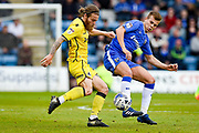 Bristol Rovers midfielder Stuart Sinclair (24) and Gillingham midfielder Mark Byrne (33) during the EFL Sky Bet League 1 match between Gillingham and Bristol Rovers at the MEMS Priestfield Stadium, Gillingham, England on 14 April 2017. Photo by Martin Cole.