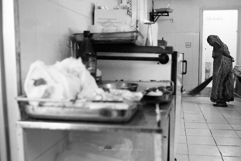 A cleaning lady sweeps the floor of the labour room. Lack of hygiene is a big problem in Pakistan causing many complications during or after childbirth. Karachi, Pakistan, 2010