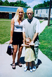 19 Jan,2006. Collect photograph.  Happier days near St Joseph, Kansas.  Marshall Bruce Masthers III, aka Eminem at his first wedding to Kimberly Anne Scott in 1999 with daughter Hailie outside the service. <br /> Photo Credit: Kresin via  www.varleypix.com