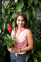 Woman with Potted Tropical Plant