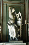 Apollo with lyre: In Greek pantheon, god of music, poetry, archery, prophecy and healing and sometimes identified with the Sun (Helios):  The model of manly beauty. Roman marble statue