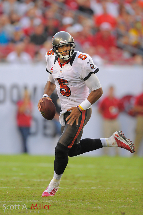 Tampa Bay Buccaneers quarterback Josh Freeman (5) runs upfield during the Bucs game against the Carolina Panthers at Raymond James Stadium  on September 9, 2012 in Tampa, Florida.  The Bucs won 16-10..©2012 Scott A. Miller...