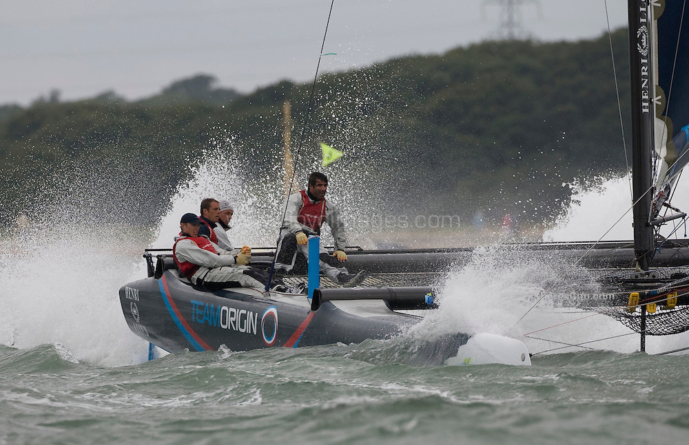"""Day three of Skandia Cowes Week 2008 (Sunday) ..iShares Cup Extreme 40 racing...""""Team Origin"""" skippered by Rob Greenhalgh just behind """" Alinghi"""" which is skippered by Ed Baird...Please credit all pictures """"Lloyd Images"""""""