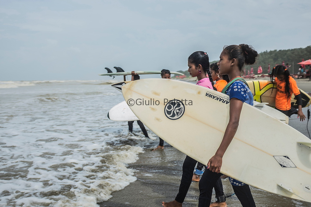 The girls are getting ready for surfing at Cox's Bazar's beach, Bangladesh