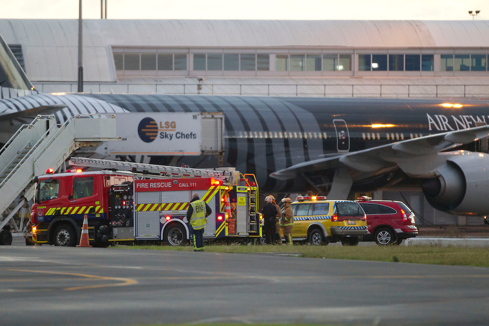 Fire crew on standby after a report of a radiation leak from freight on a Singapore Airlines Cargo Boeing 747 at the International Airport Terminal, Auckland, New Zealand, Thursday, February 16, 2012. Credit:SNPA / Simon Runting